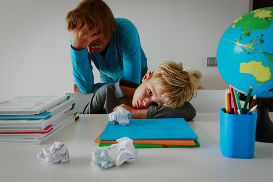 father and son stressed tired of doing homework together