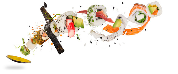 Printed kitchen splashbacks Sushi bar Pieces of delicious japanese sushi frozen in the air.