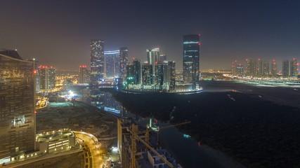 Buildings on Al Reem island in Abu Dhabi night timelapse from above.