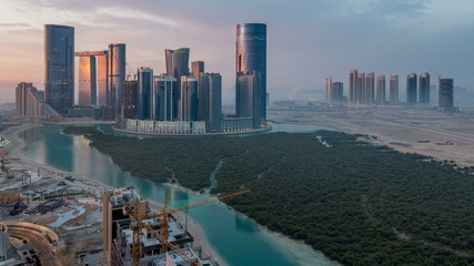 Photo sur Aluminium Abou Dabi Buildings on Al Reem island in Abu Dhabi timelapse from above.