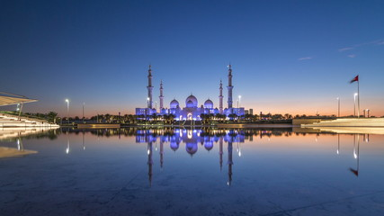 Sheikh Zayed Grand Mosque in Abu Dhabi day to night timelapse after sunset, UAE