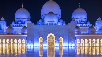 Sheikh Zayed Grand Mosque illuminated at night timelapse, Abu Dhabi, UAE. Wall mural
