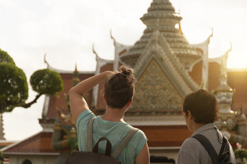 Wall Mural - Tourists are sightseeing inside Wat Arun in Bangkok, Thailand.