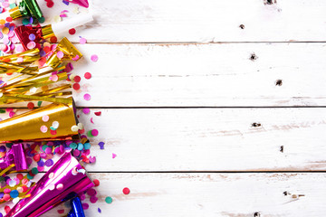 Party background. Party caps and confetti on white wooden background. Top view. Copyspace