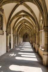 Sunlight through the arches of a corridor in a medieval cloister