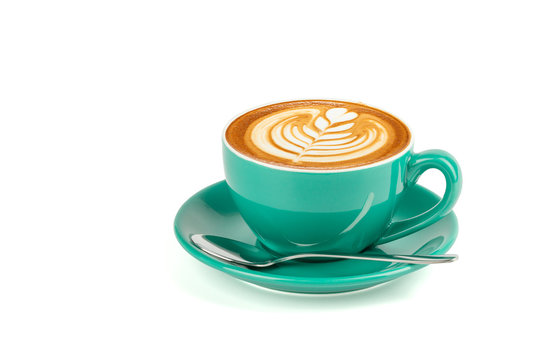 Side view of hot latte coffee with latte art in a green cup and saucer isolated on white background with clipping path inside.