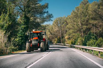 Tractor With Fertilizer Applicator With Tank In Motion On Countr