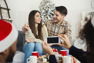 Couple capturing lovely Christmas moment