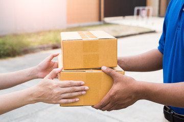 Close up hands accepting a delivery of boxes from deliveryman. Image of Delivery, Courier, Service, Shipment, Import Export Concept.