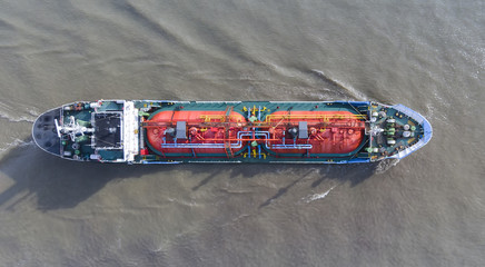 Aerial shot/Gas tankers are traveling at sea to transport gas to destinations.