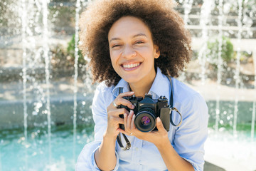 Happy African Woman With Retro Camera Outdoor