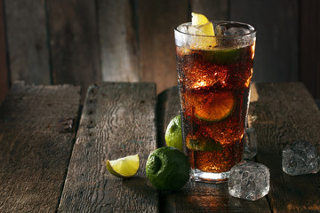 Fototapeta Cocktail with ice coke and lime