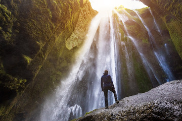 Gljufrabui waterfall in South Iceland,  adventurous traveller standing in front of the stream cascading into the gorge or canyon, hidden Icelandic landmark, inspirational landscape