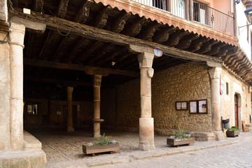 arcade that shelters the market on rainy days, Main square of  San Martin del Castanar; Salamanca province; Castilla Leon; Spain