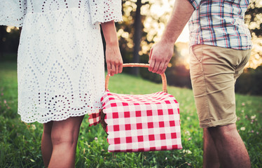 Couple going to picnic. Love and tenderness, dating, romance, lifestyle concept
