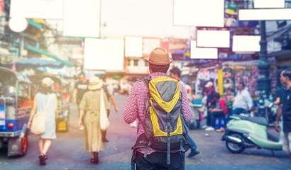 Traveling man walking in Khaosan Road walking street at Bangkok