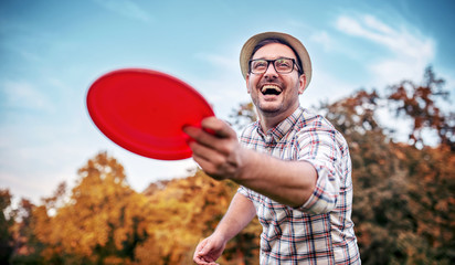 Man playing frisbee. Sport and recreation concept.