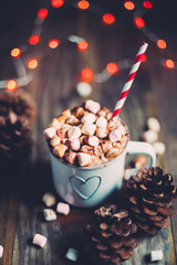Christmas hot chocolate on a rustic wooden table