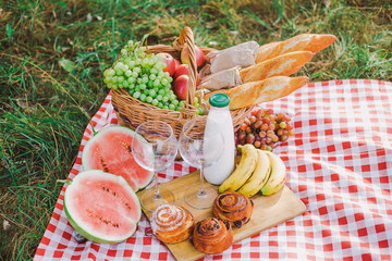 Acrylic Prints Picnic Healthy food for picnic outside. Closeup view of fresh buns, bread, yogurt, bananas, watermelon, green grape and red apples. Horizontal color image.