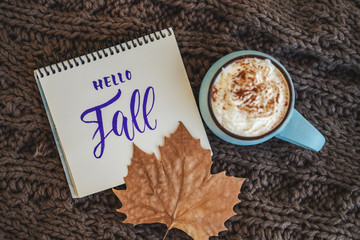 Printed roller blinds Chocolate Mug of coffee, cocoa or hot chocolate with whipped cream and cinnamon on knitted scarf, leaf. sign Hello, Fall. Pumpkin latte autumn cozy drink. Concept of warm home autumn.