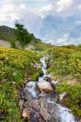 Beautiful alpine scenery with waterfall, waterfall in Alps