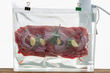 Portion of flat iron beef steak sous-vide cooking