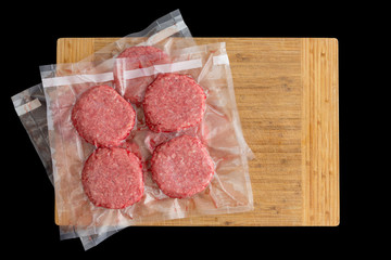 Isolated beef burger patties prepared for freezing