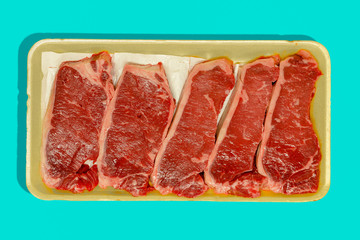 Retail packaging with five raw flat iron steaks