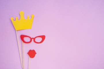 Photo booth props on pink background with copyspace.