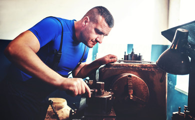 Operator working on the lathe machine. Concept of industry