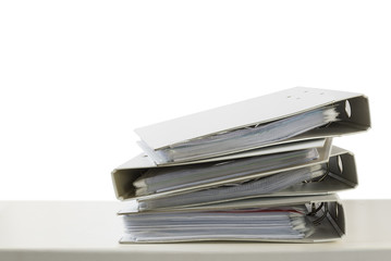 stack of folders on a desk isolated on a white background, business and finance concept, copy space
