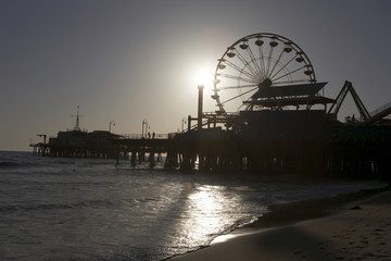 Ferris wheel on pier at dusk