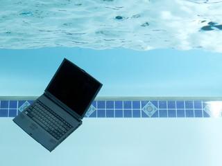 Laptop in swimming pool