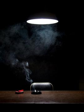 Burning cigarette in interrogation room