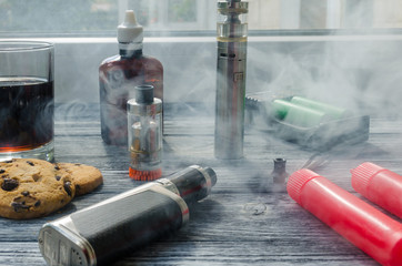 Still life with e-ciggarete and coffe on the wooden background
