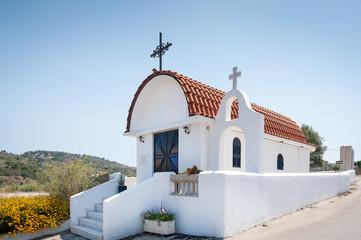 Traditional small whitewash Greek Orthodox Chapel.