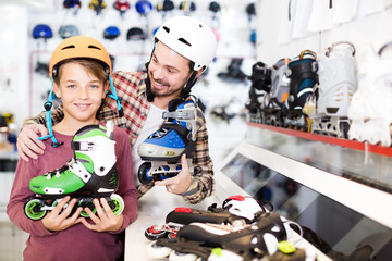 Father and son examining various roller-skates