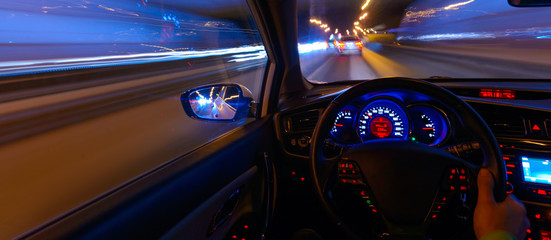 Movement of the car at night at a speed view from the interior, Brilliant road with lights with a car at high speed
