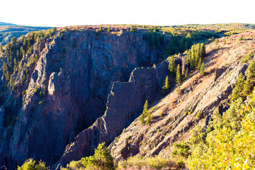 Steep, rocky black cliffs and eroded ridges characterize the landscape of Black Canyon of the Gunnison National Park in Colorado