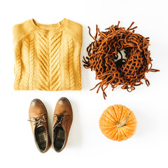 Fall autumn woman fashion clothes look. Pullover, shoes, scarf and pumpkin on white background. Flat lay, top view.