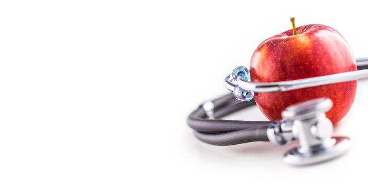 Close-up stethoscope and red apple  on white background