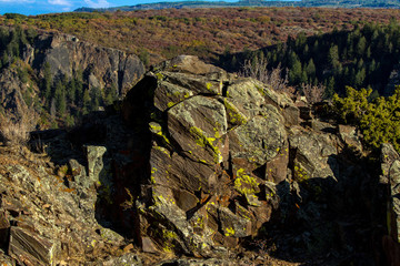 Colorful boulder rests at the top of a cliff at Black Canyon of the Gunnison National Park in Colorado