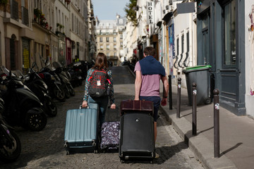 Couple of tourists arriving in Montmartre district of  Paris.