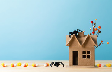 Halloween themed mini craft house on a blue background