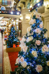 Photo of New Year decorated with white flowers fir in shop