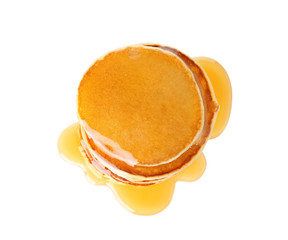 Stack of tasty pancakes with maple syrup on white background, top view