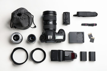 Flat lay composition with photographer's equipment and accessories on white background