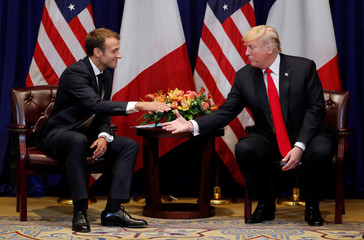 France's President Macron reaches out to shake hands as he holds bilateral meeting with U.S. President Trump on sidelines of UN General Assembly in New York