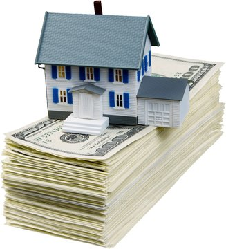 Savings for buying the house. Dollar bils and house model