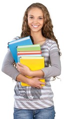 Friendly Young Girl Standing and Holding Books - Isolated